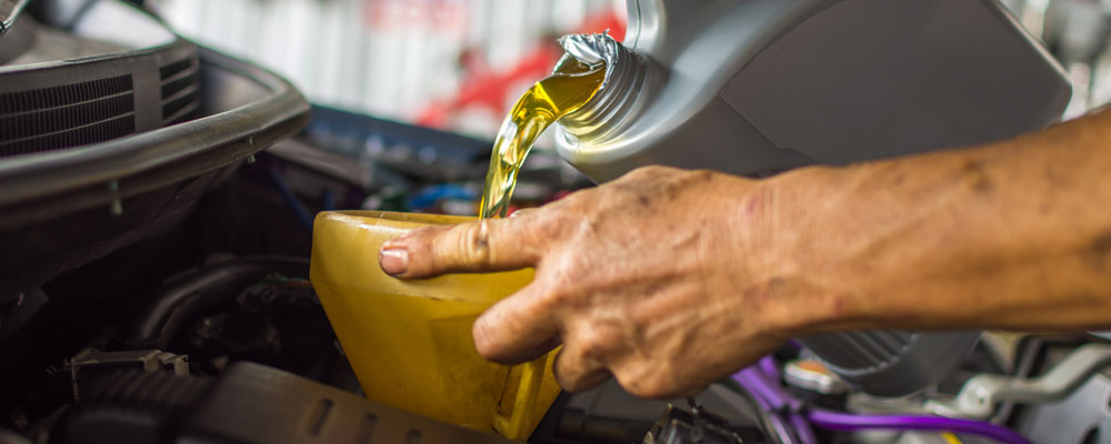 Car Mechanic Replaces Engine Oil - Car Servicing Woodbridge